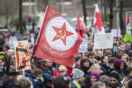 Amsterdam, The Netherlands - February 6,2016: public multi-cultural demonstration organized to protest against racism and islamophobia named Refugees welcome, racism not!