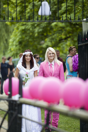 Amsterdam, the Netherlands - July 23, 2016: Fake burlesque weddings held during Pink Saturday Gay Euro Pride celebrations in Vondelpark