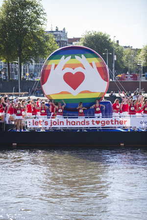 identidad cultural: Amsterdam, the Netherlands - August 06, 2016: participants in the annual event for the protection of human rights and civil equality - Gay Pride Parade on the canals during Euro Pride 2016