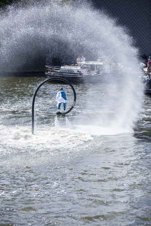 Amsterdam, the Netherlands - August 06, 2016: man making figures with a flyboard during the annual event for the protection of human rights and civil equality - Gay Pride Parade on the canals during Euro Pride 2016
