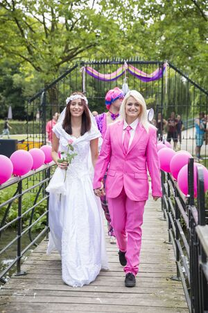 Amsterdam, the Netherlands - July 23, 2016: Fake burlesque weddings held during Pink Saturday Gay Euro Pride celebrations in Vondelpark