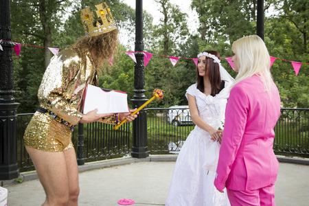 bisexual women: Amsterdam, the Netherlands - July 23, 2016: Fake burlesque weddings held during Pink Saturday Gay Euro Pride celebrations in Vondelpark