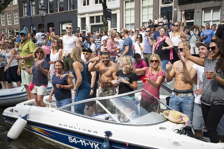 bisexual women: Amsterdam, Netherlands - August 1, 2015: participants in the annual event for the protection of human rights and civil equality - Gay Pride Parade on the Prinsengracht, Amsterdam