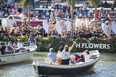 transexual: Amsterdam, the Netherlands - August 06, 2016: participants in the annual event for the protection of human rights and civil equality - Gay Pride Parade on the canals during Euro Pride 2016