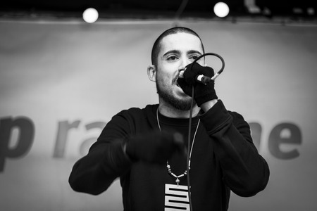 Amsterdam, The Netherlands - February 6,2016: public multi-cultural demonstration organized to protest against racism and islamophobia named Refugees welcome, racism not!. Dutch rapper Insayno is performing to contest against racism
