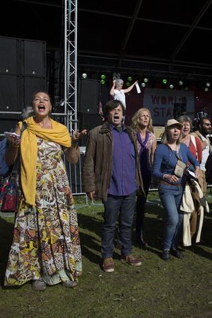rythm: Amsterdam, The Netherlands - July, 3 2016: People performing a music and singing flashmob at Amsterdam Roots Open Air, free public cultural festival held in Oosterpark