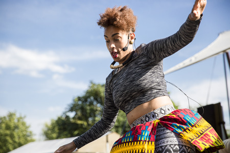 danza africana: Amsterdam, The Netherlands - July, 5 2015: African dance workshop during Amsterdam Roots Open Air, a cultural festival held in Park Frankendael on 05072015