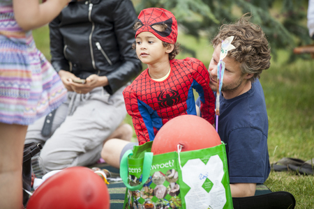 Amsterdam, The Netherlands - July, 5 2015: father and son dressed a spidermanduring Amsterdam Roots Open Air, a cultural festival held in Park Frankendael on 05072015