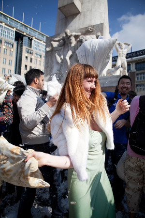 noord: Amsterdam, The Netherlands, Noord Holland - Saturday, April 5 2014 - Pillow Fight on Dam Square