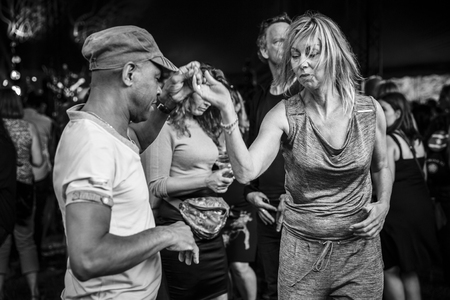 Amsterdam, The Netherlands - July, 5 2015: during the concert of Colombian band LA-33 - people dancing salsa during Amsterdam Roots Open Air, cultural festival held in Park Frankendael on 05072015