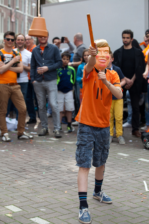 Amsterdam, The Netherlands, April 30, 2014: celebration of the public national holiday Kings day - Koningsdag - held every year on 30th of April in the entire country to celebrate King Willems birthday
