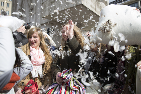 noord: Amsterdam, The Netherlands, Noord Holland - Saturday, April 4 2015 - Pillow Fight on Dam Square as part of the international pillow fight day held in several cities in the world Editorial