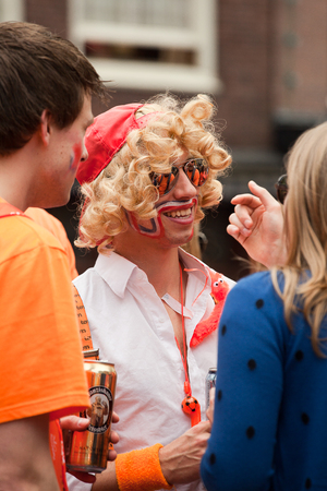 dutch girl: Amsterdam, The Netherlands, April 30, 2014: celebration of the public national holiday Kings day - Koningsdag - held every year on 30th of April in the entire country to celebrate King Willems birthday