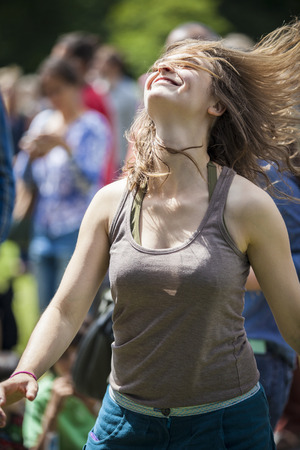 Amsterdam, The Netherlands - July, 3 2016: girl dancing at concert of alternative Electro-Hip Hop Moroccan band N3rdistan at Amsterdam Roots Open Air, free public cultural festival held in Oosterpark Editorial