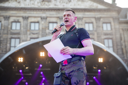 identidad cultural: Amsterdam, the Netherlands – July23, 2016: opening party on Dam square during Pink Saturday celebrations of the Gay EuroPride, speech of Organisor of EuroPride Amsterdam 1994, Hans Verhoeven