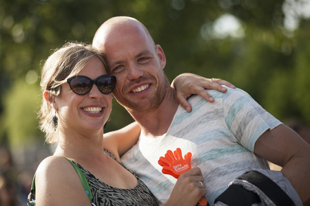Amsterdam, The Netherlands - July, 5 2015: happy couple during Amsterdam Roots Open Air, a cultural festival held in Park Frankendael on 05072015