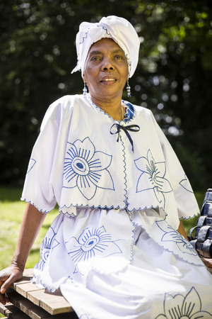 Amsterdam, The Netherlands - July, 3 2016: old Caribbean woman in a traditional dress at Roots Open Air festival, free public event in Oosterpark Amsterdam