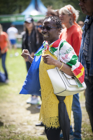Amsterdam, The Netherlands - July, 3 2016: black woman in the audience at concert of alternative Electro-Hip Hop Moroccan band N3rdistan at Amsterdam Roots Open Air, free public cultural festival held in Oosterpark Editorial