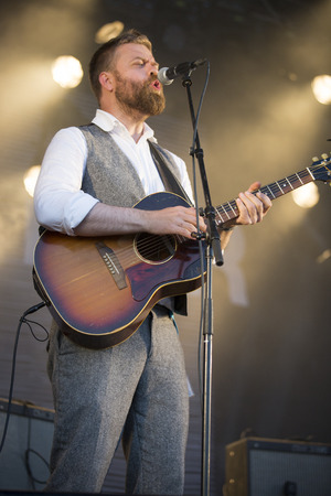 Traena, Norway - July 12 2014: during the concert of the Icelandic singer Mugison at the Traenafestival, music festival taking place on the small island of Traena