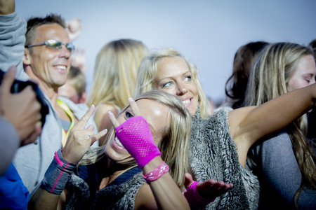 festival moment: Traena, Norway - July 12 2014: during the concert of the Danish electro-rap singer Linkoban at the Traenafestival, music festival taking place on the small island of Traena