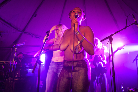 Traena, Norway - July 11 2014: at the concert of the Norwegian electronic soul singer Nosizwe at the Traenafestival, music festival taking place on the small island of Traena