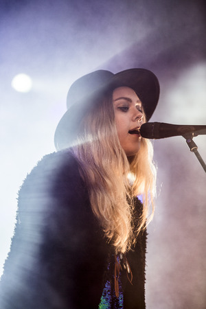Traena, Norway - July 10 2014: during the concert of the Swedish rock band First Aid Kit at the Traenafestival, music festival taking place on the small island of Traena