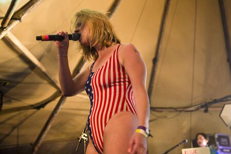 norway flag: Traena, Norway - July 11 2015: concert of Norwegian band Kuuk, at Traenafestival, music festival taking place on the small island of Traena. Editorial