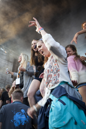 johannes: Traena, Norway - July 11 2014: during the concert of the Norwegian band Ida Maria at the Traenafestival, music festival taking place on the small island of Traena