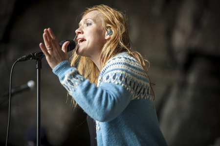 Traena, Norway - July 11 2015: concert of Norwegian singer Anneli Drecker at cathedral cave Kirkehelleren on Sanna Island, at Traenafestival, music festival taking place on the small island of Traena. Editorial
