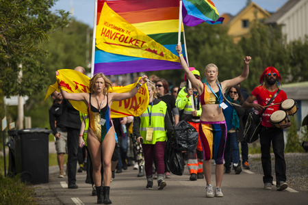 bisexual women: Traena, Norway - July 11 2015: group of colorful people participating in the smallest gay Pride in Europe during Traenafestival, music festival taking place on the small island of Traena. Editorial