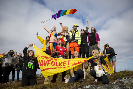 Traena, Norway - July 11 2015: group of colorful people participating in the smallest gay Pride in Europe during Traenafestival, music festival taking place on the small island of Traena. Editorial