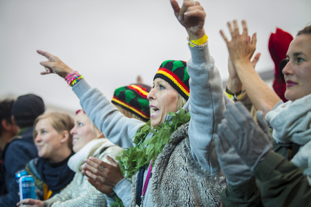 hans: Traena, Norway - July 10 2015: audience arms up in the air at concert of Norwegian band Kim Lie og hans Langt Nord Bandat the Traenafestival, music festival taking place on the small island of Traena Editorial