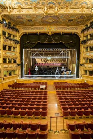 prestigious: VENICE, ITALY - December 26, 2015: interior of historical theatre La Fenice. Rebuilt after it was destroyed by the fire in 1996, the famous opera house reopened in 2003