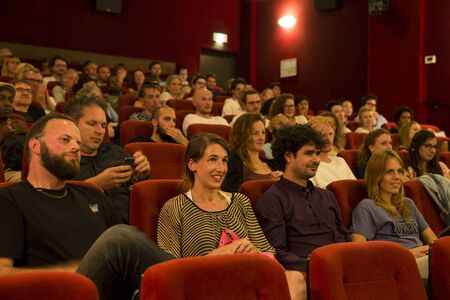 award ceremony: Amsterdam, The Netherlands - August 22 2015: audience at award ceremony at Rialto Cinema during World Cinema Amsterdam festival, a world film festival held from 14 to 23082015. Winner was  director Sibs Shongwe for Necktie Youth.