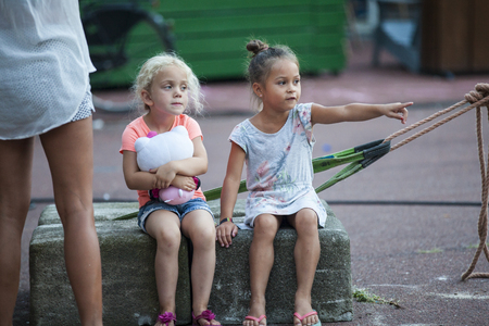 Amsterdam, The Netherlands - August 25 2016: little girls at Philippine film Blanka open air screening at Marie Heinekenplein, World Cinema Amsterdam, a world film festival held from 18 to 27082016 Editorial