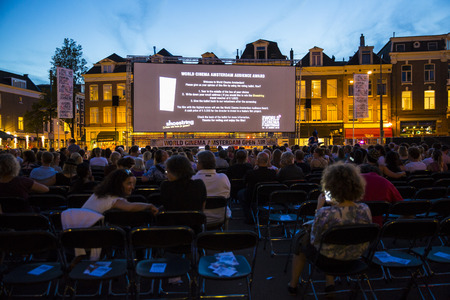 rialto: Amsterdam, The Netherlands - August 24 2016: open air screening of Argentine film Road to la Paz at Marie Heinekenplein, during World Cinema Amsterdam, a world film festival held from 18 to 27082016