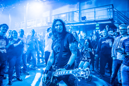 Amsterdam, The Netherlands - March 19, 2017: audience cheering while musicians of Norwegian hard rock band Audrey Horne plays in the crowd, support act of Canadian hard rock heavy metal band Danko Jones at Melkweg