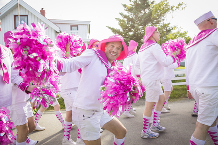 Men from the choir Oslo Fagottkor in their pink uniform participating in the Traena gay Pride during Traena festival, music festival taking place on the small island of Traena Editorial
