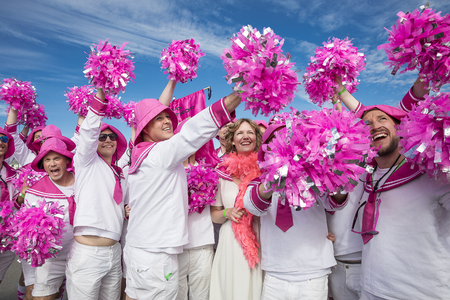 bisexual women: Traena, Norway - July 07 2017: men from the choir Oslo Fagottkor in their pink uniform participating in the Traena gay Pride during Traenafestival, music festival taking place on the small island of Traena