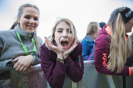 Traena, Norway - July 7 2017: portrait of a young girl screaming during concert of Norwegian rap band Sushi X Kobe at Traenafestival, music festival taking place on the small island of Traena