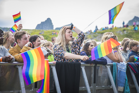Traena, Norway - July 7 2017: concert of Norwegian gay choir Oslo Fagittkor at Traenafestival, music festival taking place on the small island of Traena