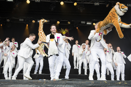 vocalist: Traena, Norway - July 7 2017: concert of Norwegian gay choir Oslo Fagottkor at Traenafestival, music festival taking place on the small island of Traena Editorial