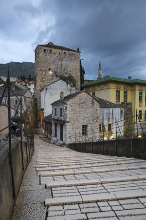 stone stairs of Old Bridge or Stari Most crossing the Neretva River, Mostar, Bosnia and Herzegovina. The Old Bridge was destroyed on 9 November 1993 by Croat military forces during the Croat–Bosniak War.