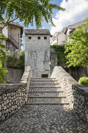 Stone stairs of an old arch bridge in Unesco area of old town Mostar, Bosnia and Herzegovina Editorial