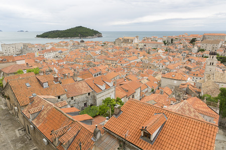 View over the orange rooftops of old town Dubrovnik from the ancient city wall with cloudy weather, Croatia