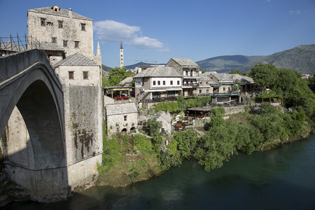 Mostar, Bosnia and Herzegovina - 20 May 2016: Old Bridge Stari Most and Neretva River. The old bridge was destroyed during the Croat-Bosniak war in 1993, reconstructed and now a World Heritage UNESCO site
