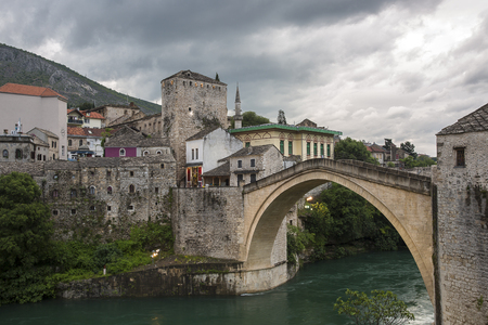 View of the single-arch Old Bridge or Stari Most crossing the Neretva River in Mostar, Bosnia and Herzegovina. The Old Bridge was destroyed on 9 November 1993 by Croat military forces during the Croat–Bosniak War.