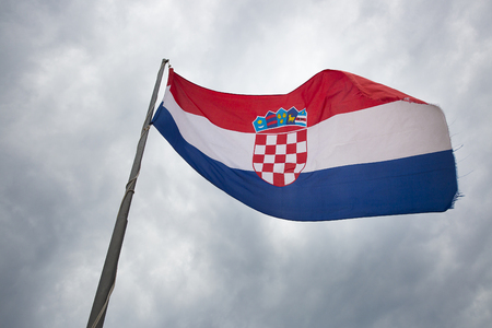 Croatian flag loating with a cloudy sky background Banco de Imagens
