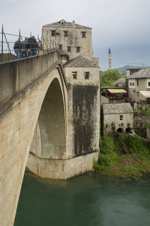View of the single-arch Old Bridge or Stari Most crossing the Neretva River in Mostar, Bosnia and Herzegovina. The Old Bridge was destroyed on 9 November 1993 by Croat military forces during the Croat�Bosniak War. The area is a UNESCO World Heritage Site.