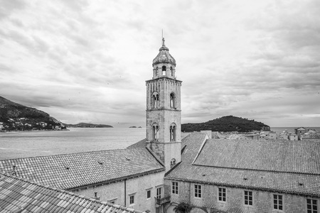 Saint Dominic Church bell tower and red roofs of the  Dominican Monastery in old town Dubrovnik, Croatia
